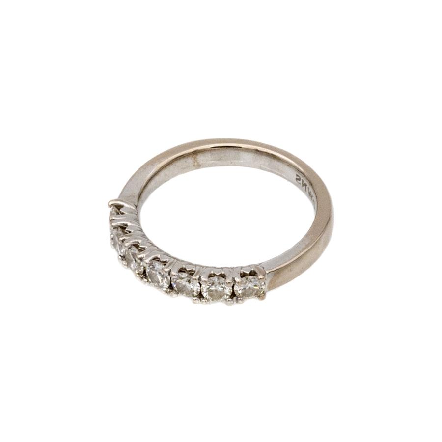 Bague demi alliance en or gris et 7 diamants