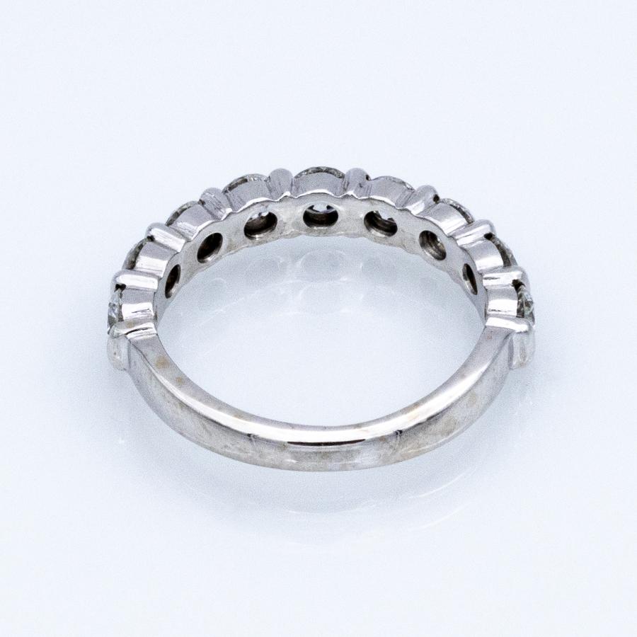 Bague demi alliance en or gris et 9 diamants