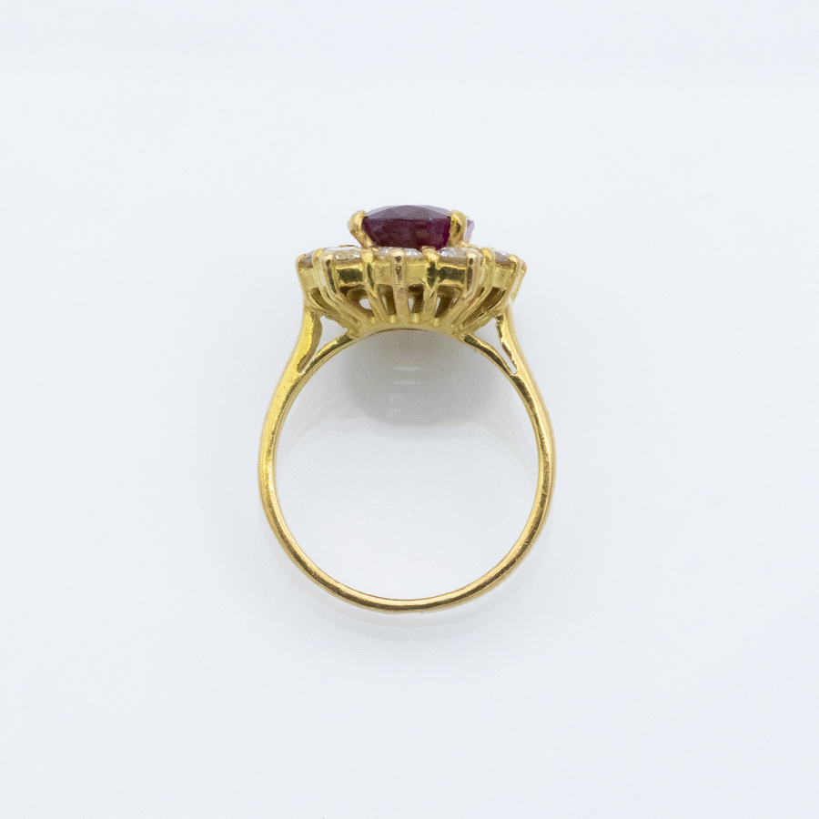 Bague marguerite en or jaune, diamants et rubis