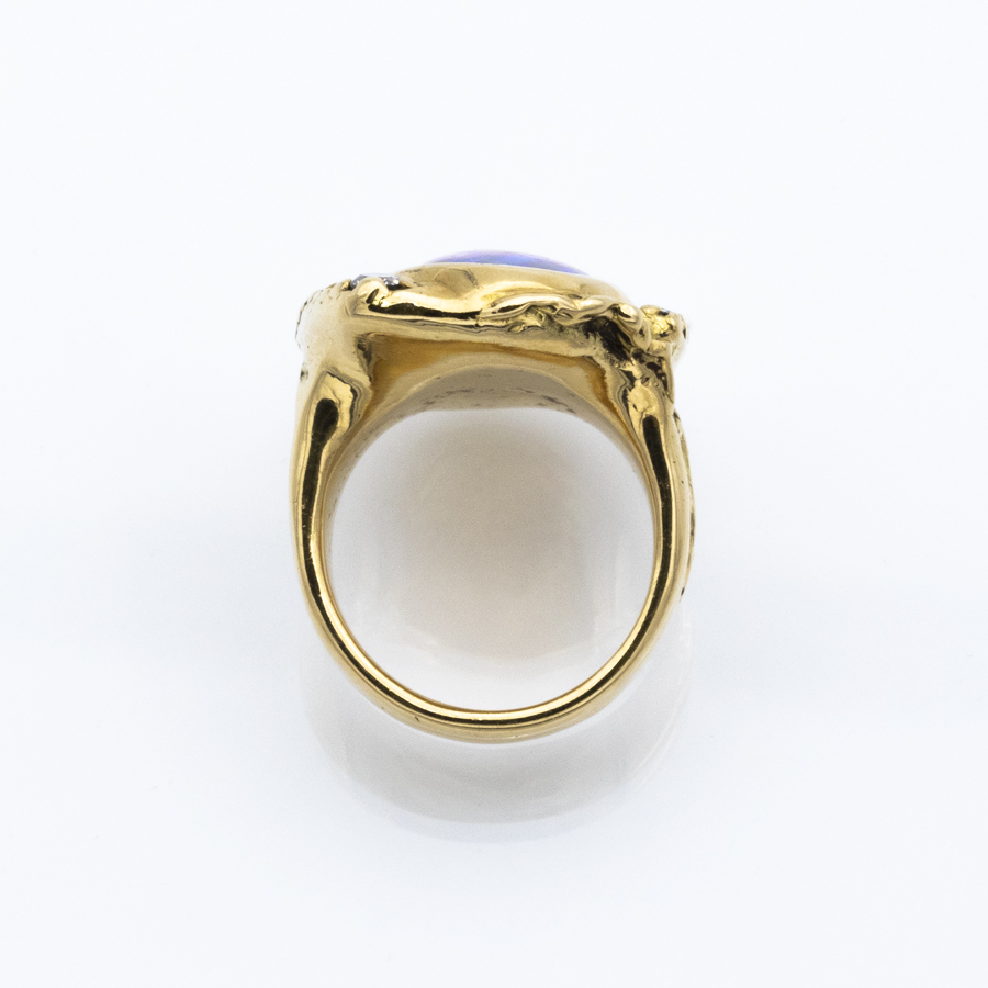 Bague jonc en or jaune, opale et 9 diamants