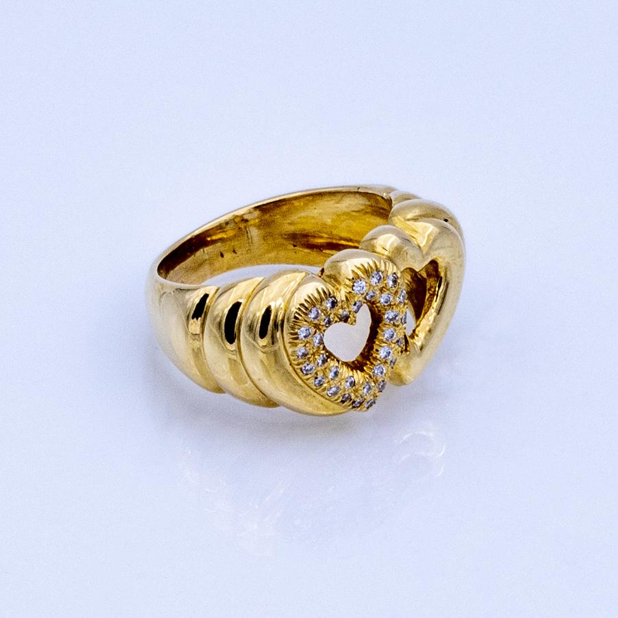 Bague double cœurs en or jaune et 32 diamants