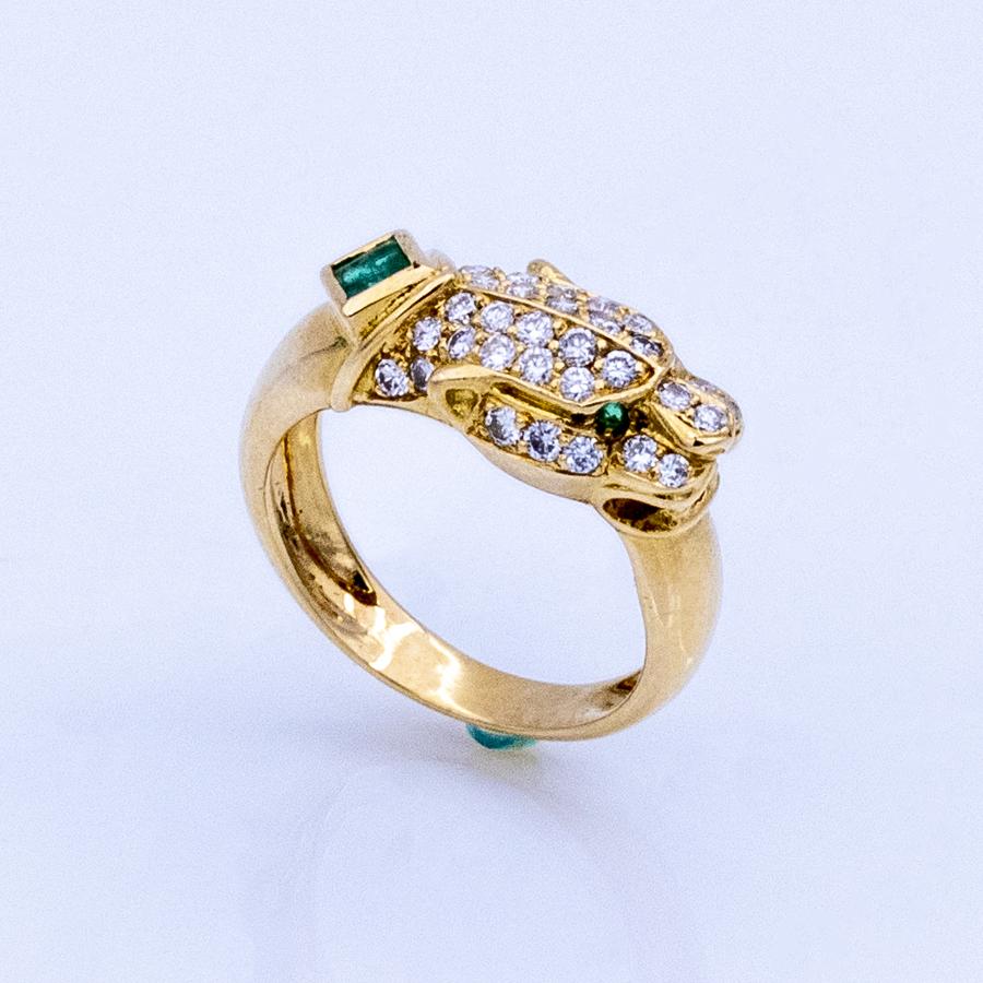 Bague Panthère en or jaune, 3 émeraudes et 36 diamants