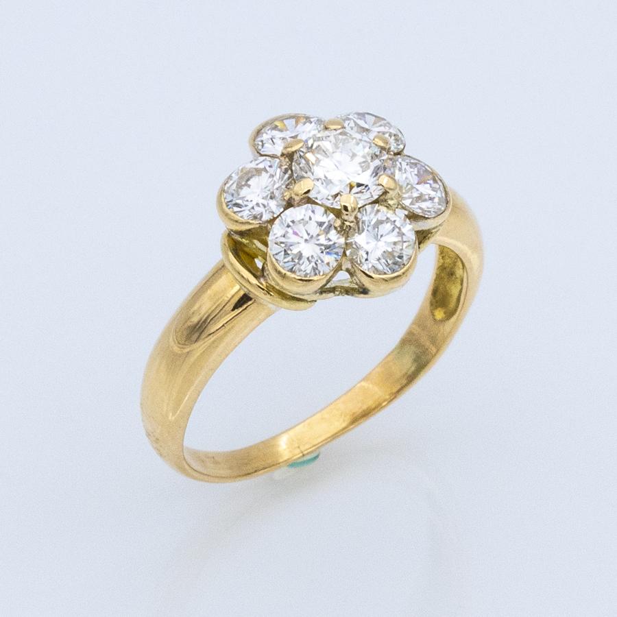 Bague entourage en or jaune et 7 diamants