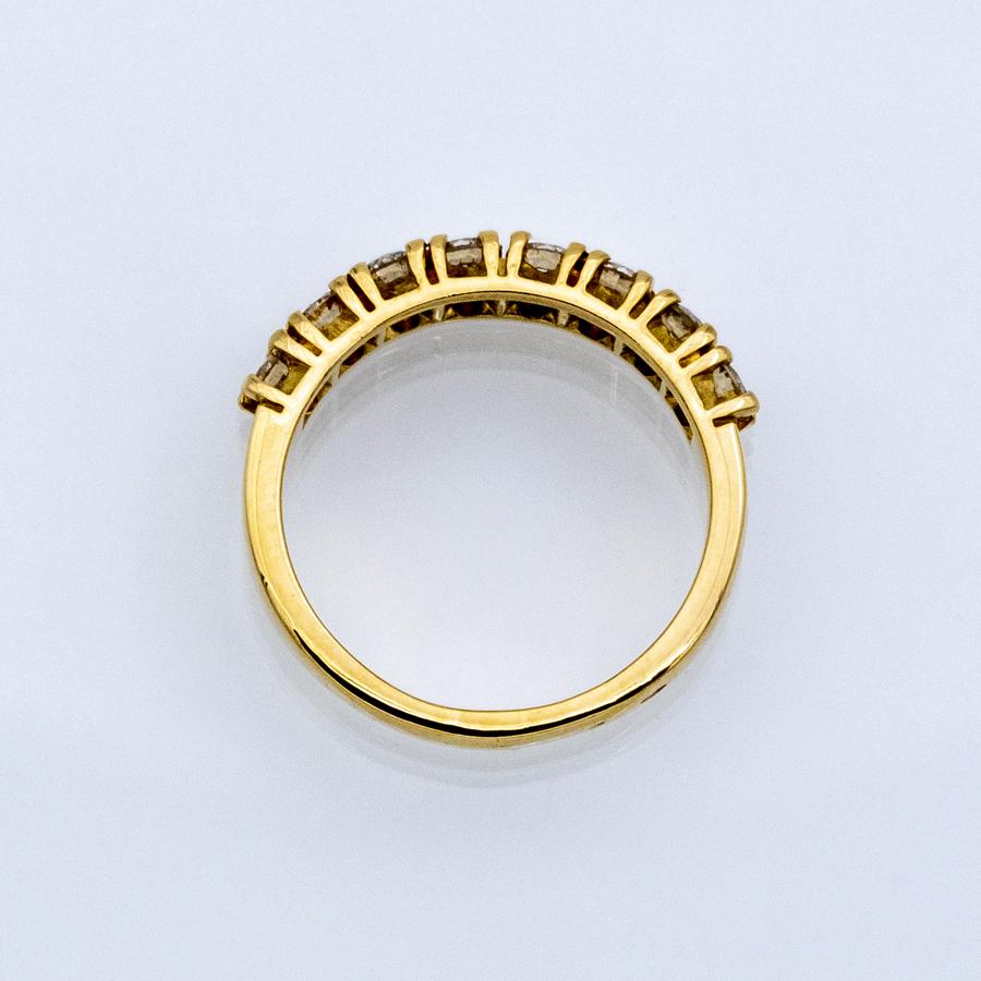 Bague demi alliance en or jaune et 8 diamants