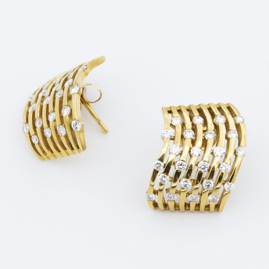 Boucles d'oreilles volutes en or jaune et diamants