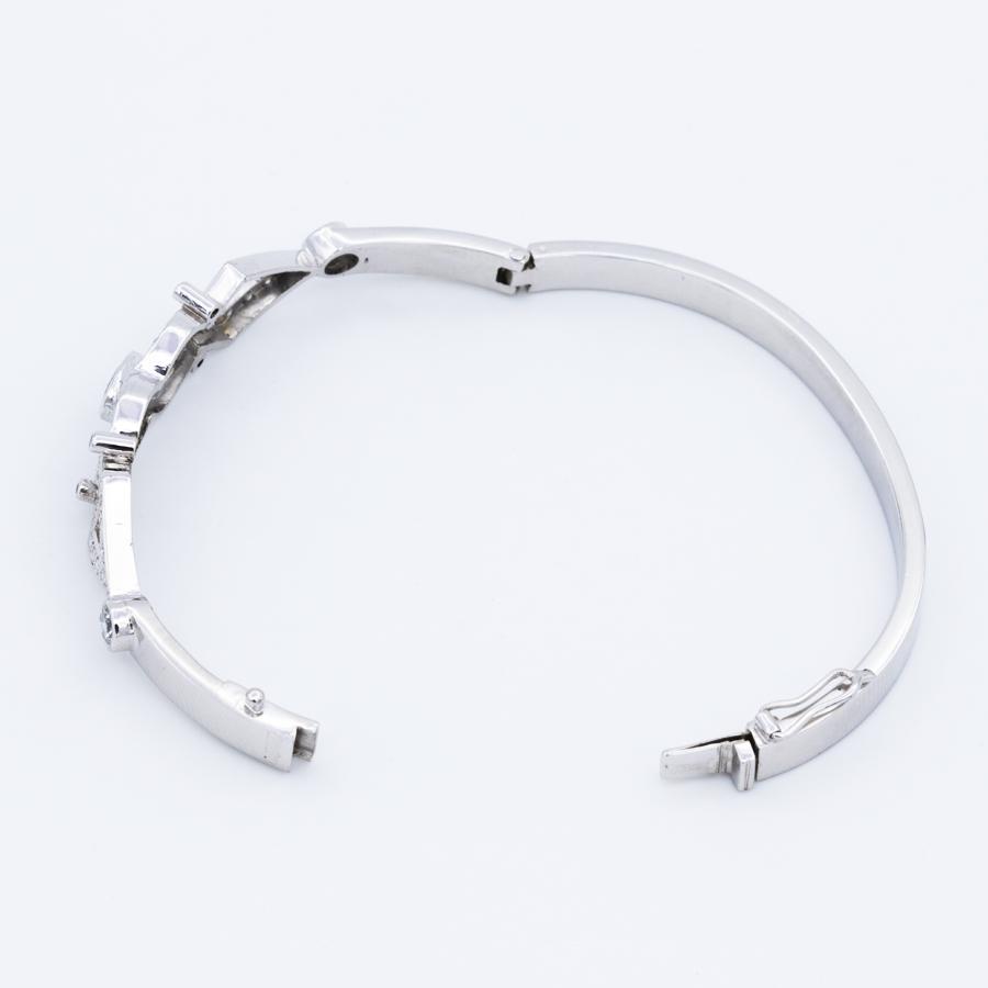 Bracelet jonc ouvrant en or gris, diamants et saphirs