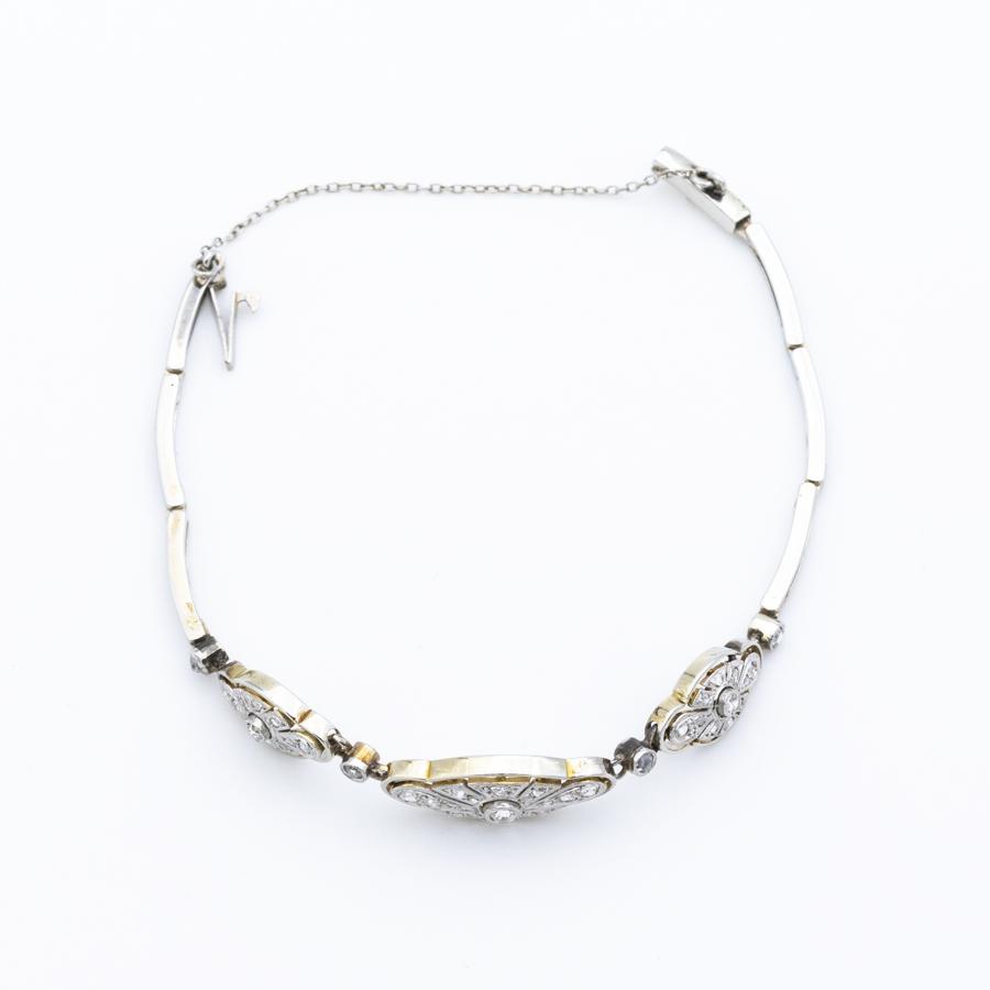 Bracelet ancien articulé en or gris et 43 diamants