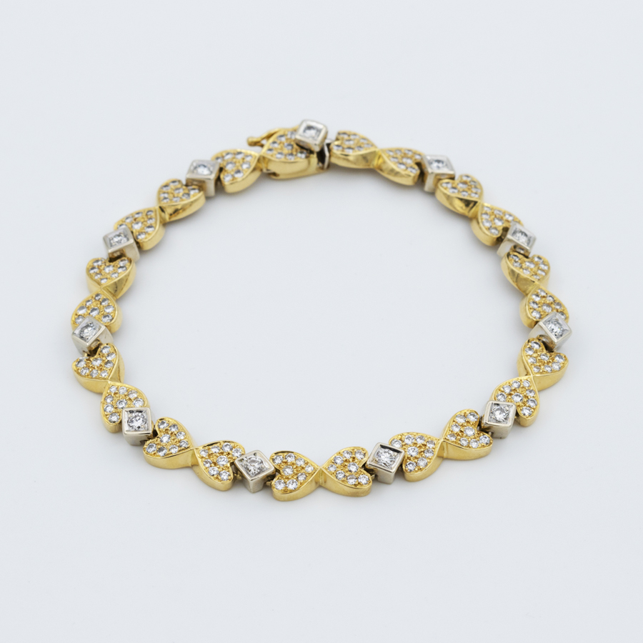 Bracelet deux ors aux mailles coeur incrustés de diamants