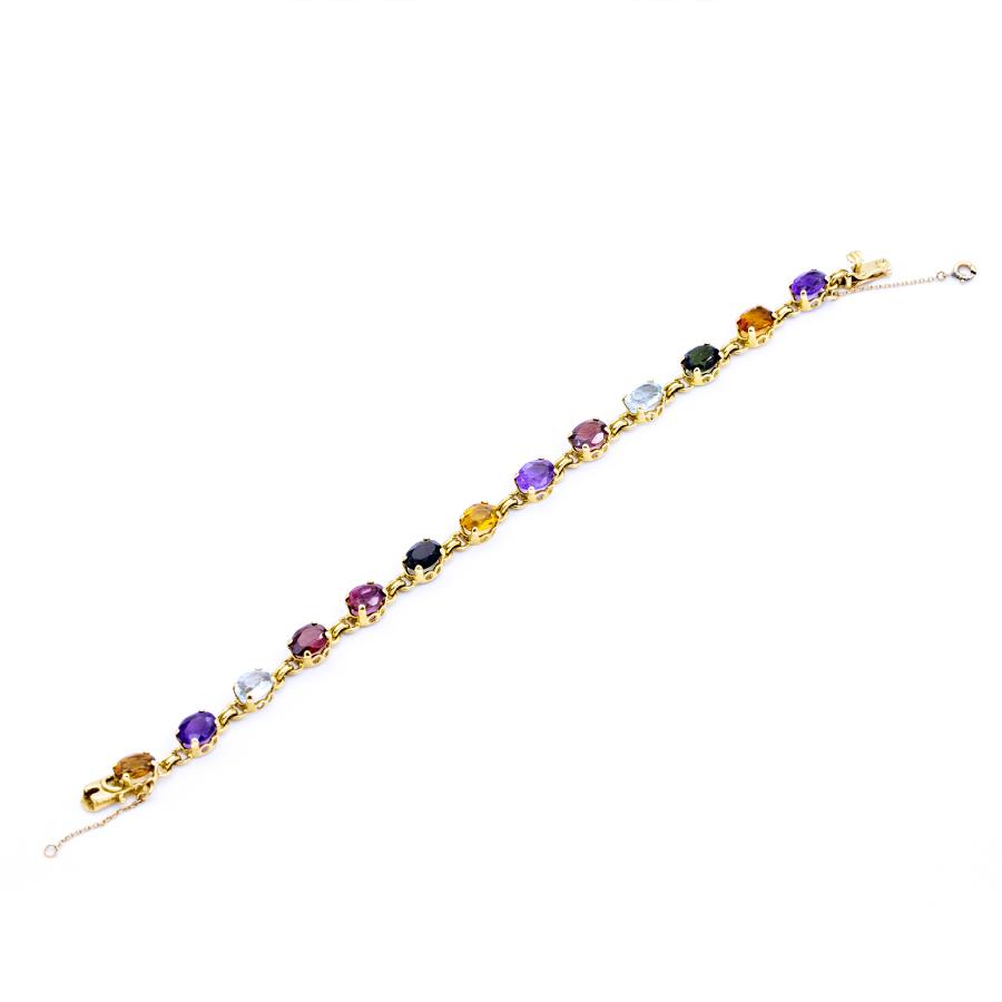 Bracelet en or jaune et pierres fines