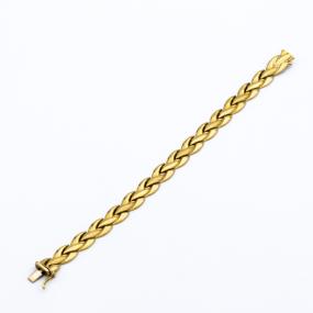 Bracelet plat articulé en or jaune