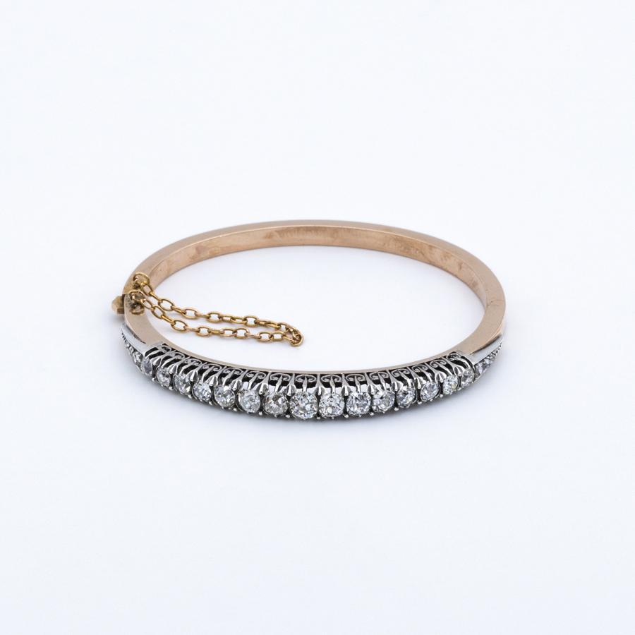 Bracelet jonc ouvrant en or et 21 diamants
