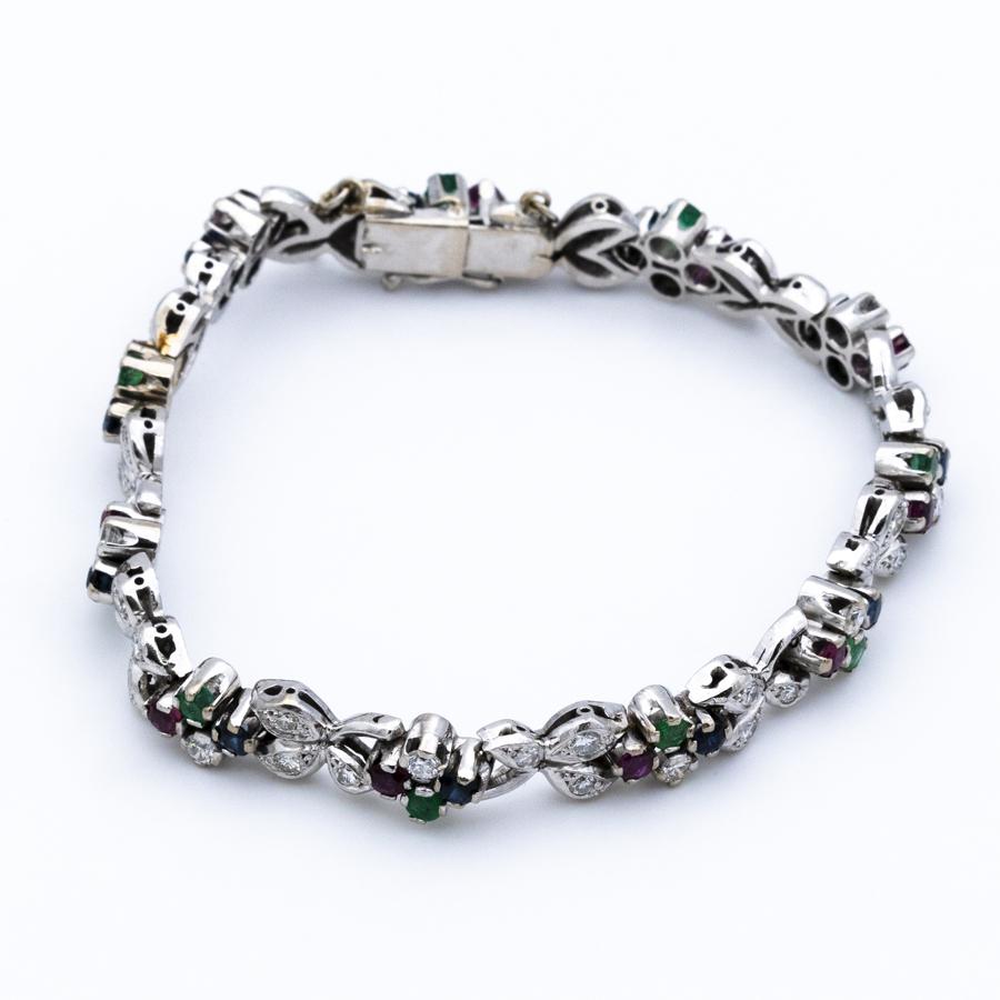 Bracelet articulé en or gris, saphirs, rubis et diamants