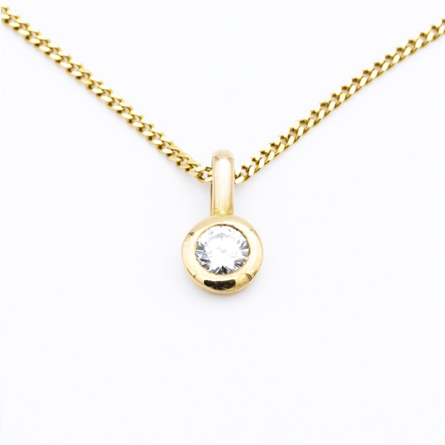 Pendentif en or jaune et diamant serti clos