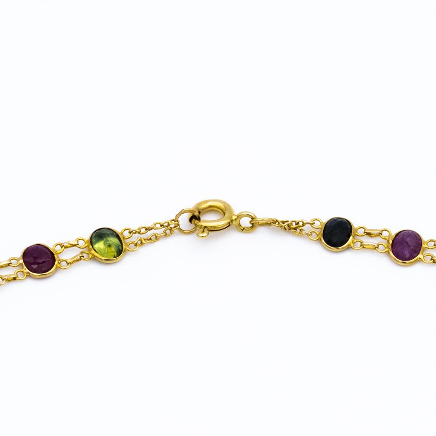 Collier double rangs en or jaune, rubis et saphirs