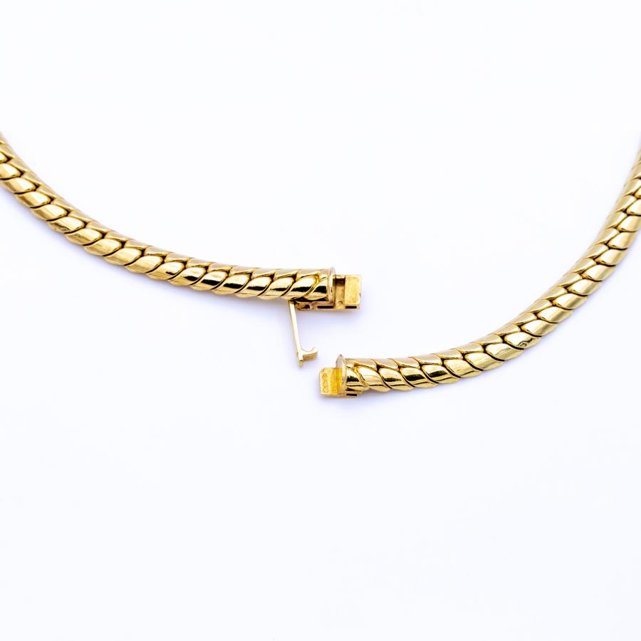 Collier Panthère en or jaune, 6 émeraudes et 80 diamants