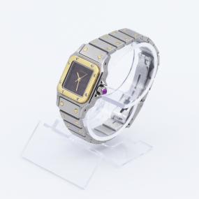 Montre Cartier automatique en or, rubis et acier