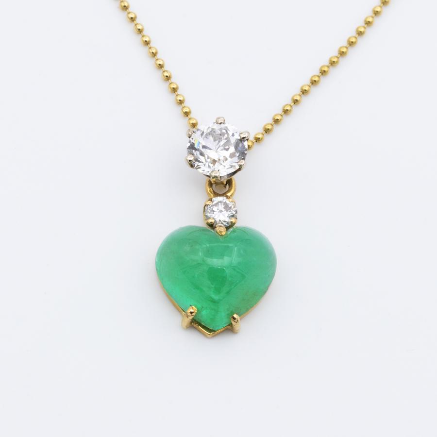 Collier pendentif en or jaune, émeraude et diamants